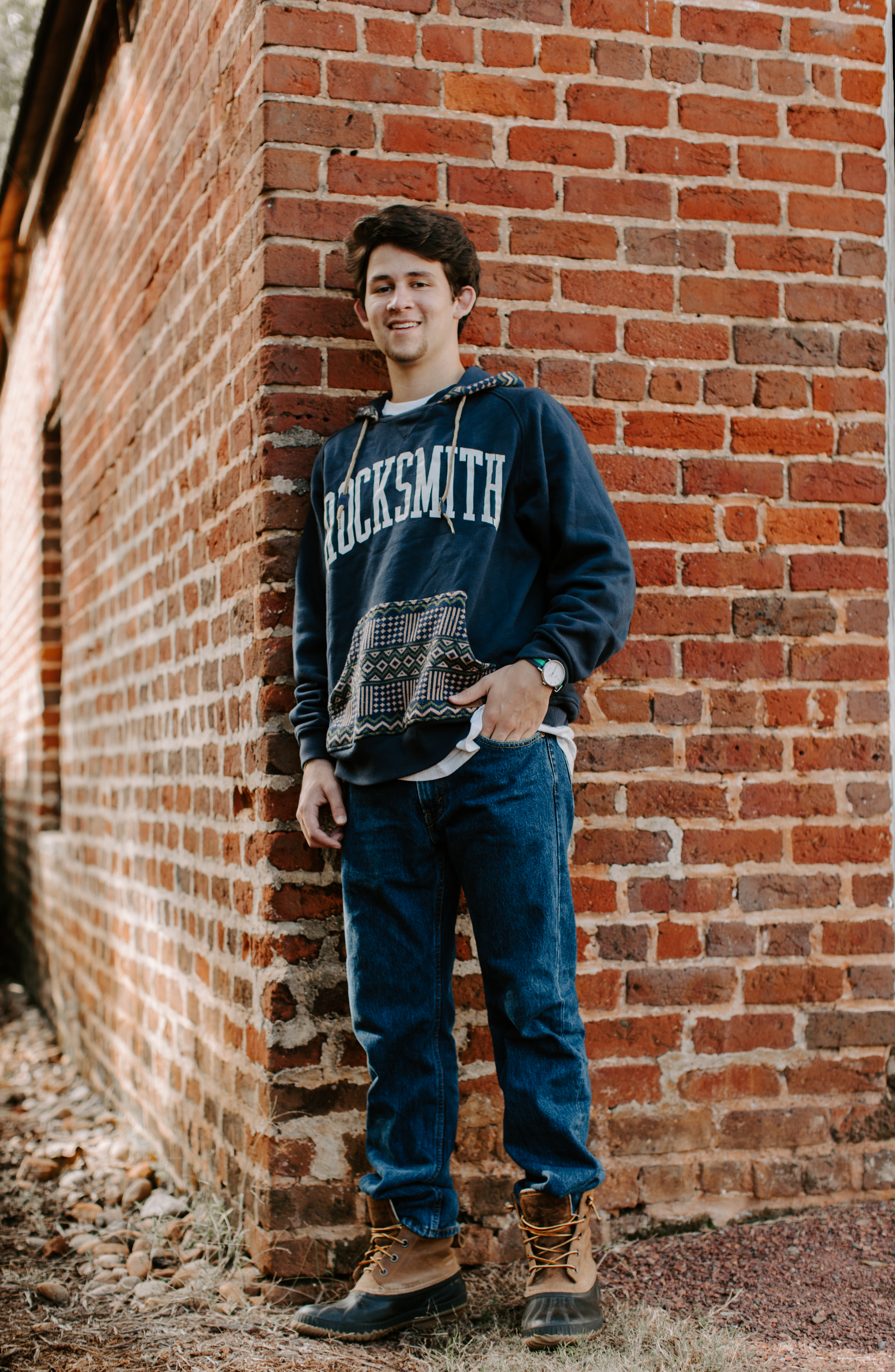 Christian O. Senior pictures collared shirt button up stairs poses pictures baseball senior garden dog and man open field golden hour sweatshirt brick wall