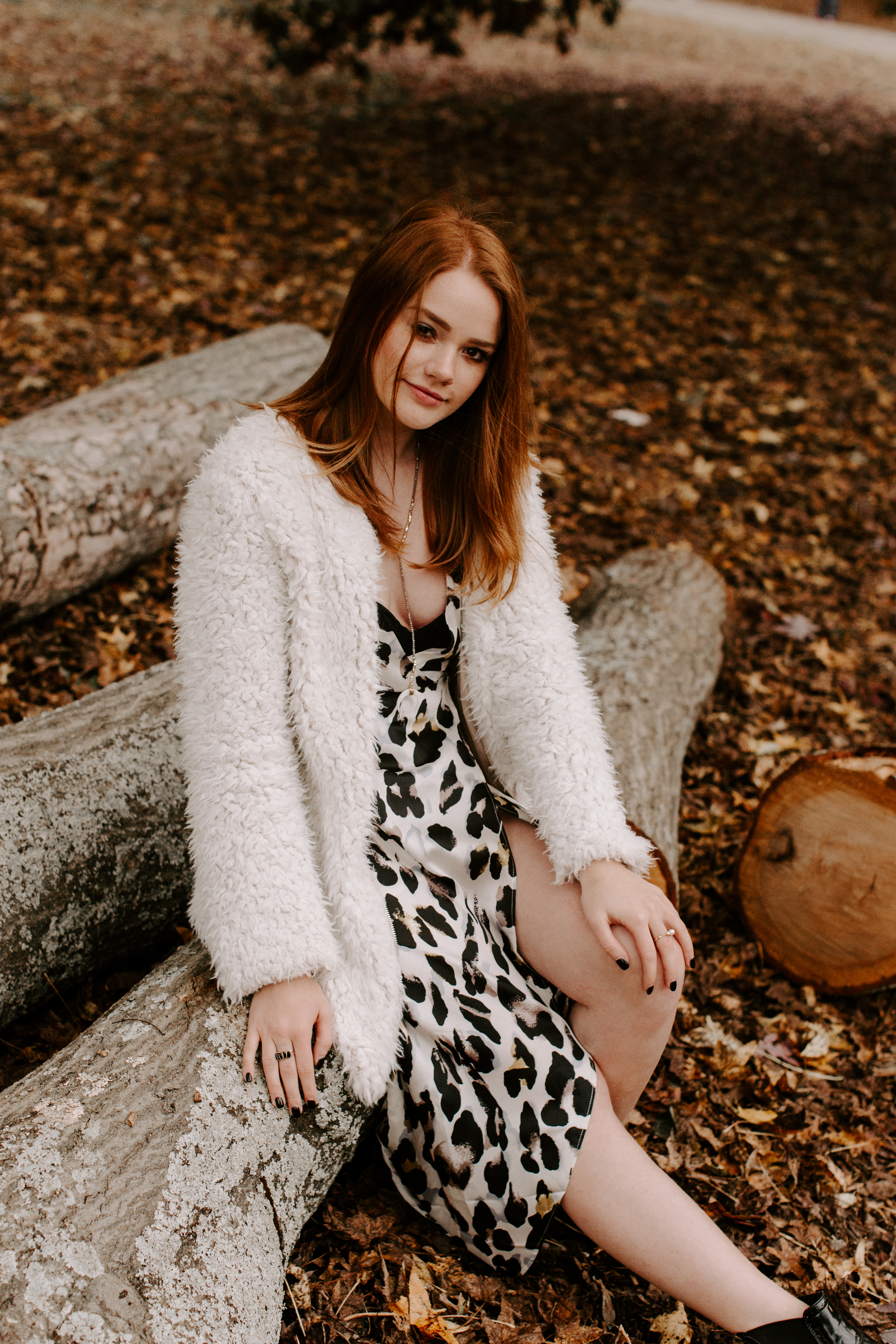 Larla H. Piedmont Park open field fall colors golden hour magazine lifestyle fashion candid pose red hair atlanta sitting on wood fuzzy sweater white dress wedding dress