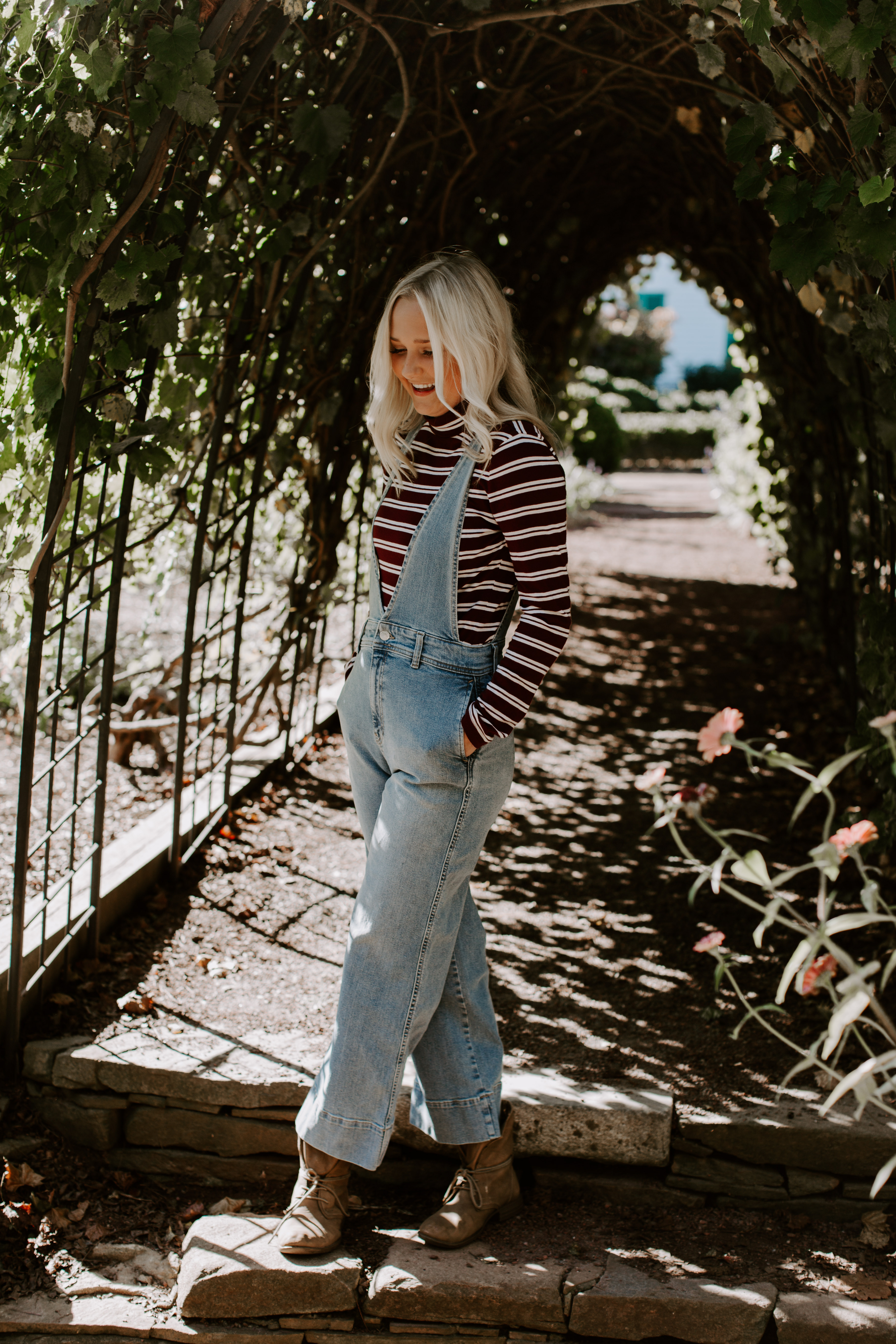 Ashley W. free people senior pictures leaf tunnel striped shirt boots candid model pose wedding elopement blonde hair outfit overalls