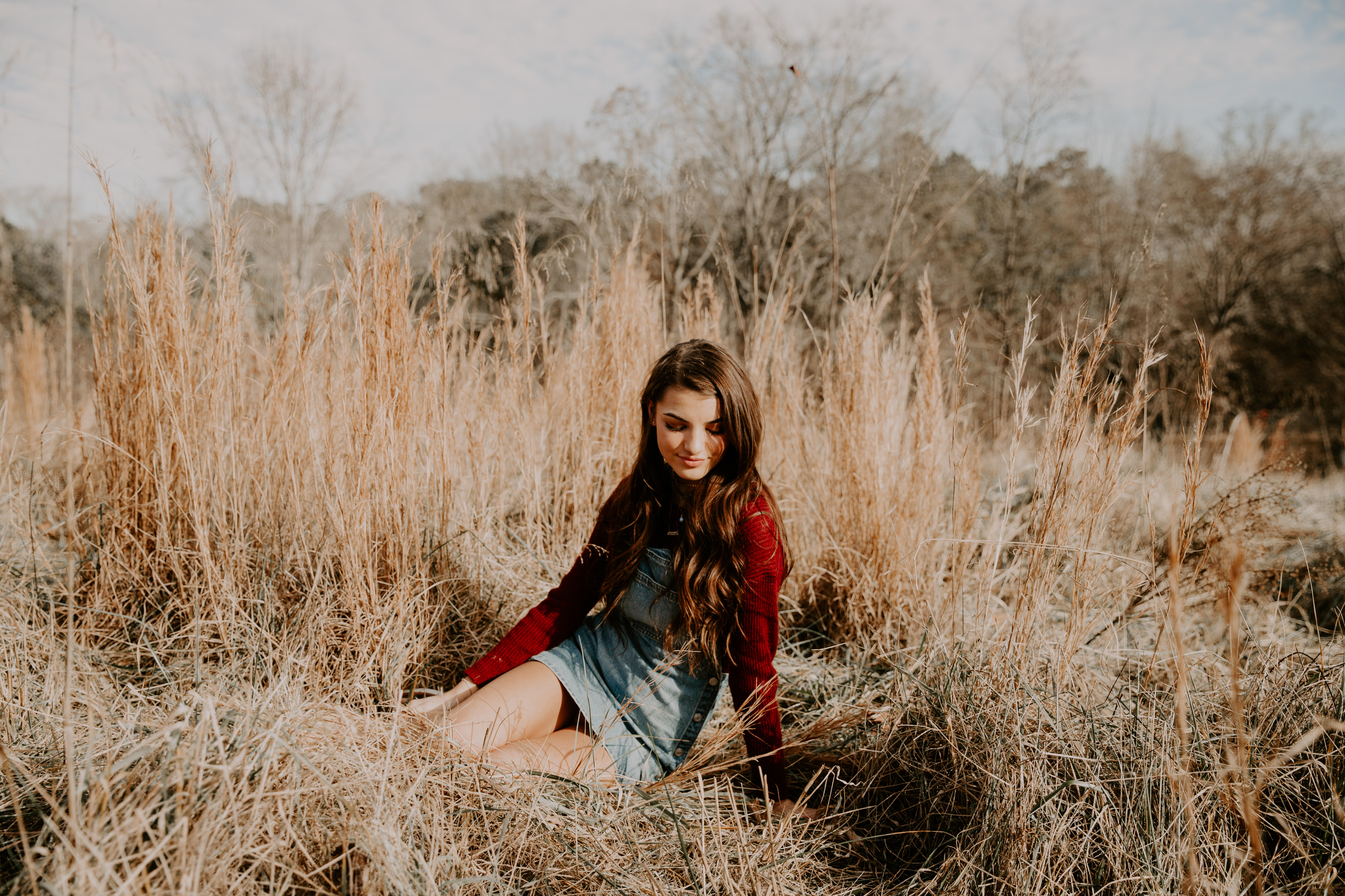 Meghan H. fence red longsleeve overalls open field pose inspiration model senior pictures Atlanta photographer smiling white house leaning Olie West bench